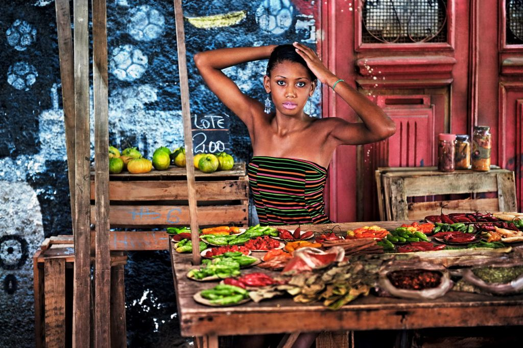Pirelli calendar 2013, A girl manning a stall, on the streets of Rio